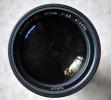 La marque se trouve ici sur le 300mm. C'est la première version. Les rayures sur la lentille ne se voient absolument pas sur les photos